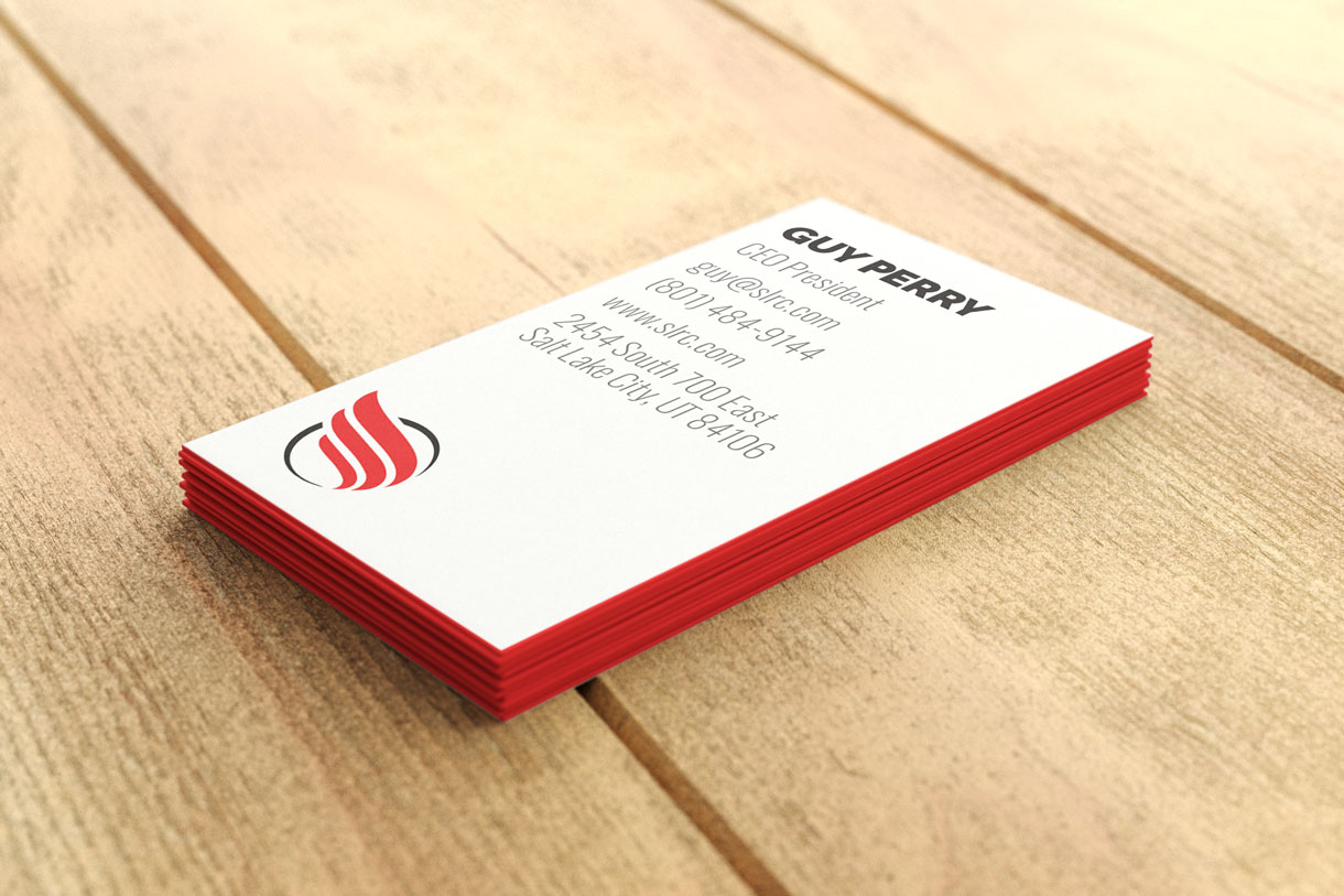 A stack of business cards designed for Salt Lake Running Company, showing the back of a business card with contact information